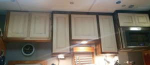 Test-fitting new cabinet doors.