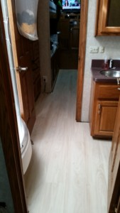 Vinyl floors in bathroom and bedroom.