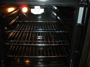 Interior of oven, with light on.