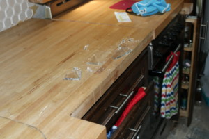Broken plate pieces on countertop
